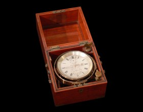 Image of a ship's chronometer housed in its wooden box